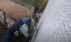Burnaby Pressure Washing cleaning the lamp